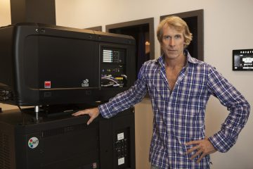Director Michael Bay in his projection room with a Barco Projector